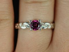 Prudence Silver Round Garnet Braided Engagement Ring (Other metals and stone options available). $85.00, via Etsy.