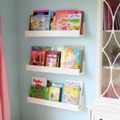 Why buy an expensive bookshelf that takes up floor space...great idea!