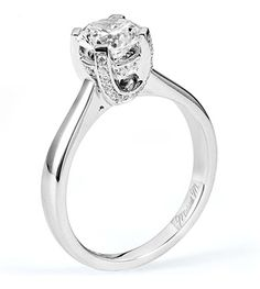 From Michael M. Collection Intricate details add pretty flair to a high-polished solitaire engagement ring.
