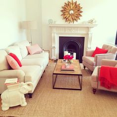 Who Wouldnt Want A Nude Living Room With Pops Of Color Through Corals Reds And Pinks
