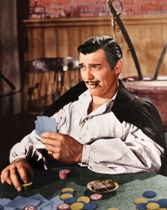 Clark Gable as Rhett Butler playing cards while being held prisoner in a Yankee jail in 'Gone With The Wind'. Rhett Butler, Clark Gable, Go To Movies, Old Movies, Great Movies, Famous Movies, Famous Faces, Margaret Mitchell, Classic Hollywood