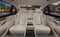 BMW 7 Series Sedan  The Rear Executive Lounge in exclusive Ivory White Nappa leather and Dark Grey Poplar wood trim.