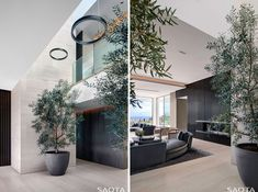 This modern entrance lobby features trees in pots and high ceilings. #Foyer #InteriorDesign #Plants #Lobby