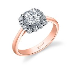 A sumptuous cushion-shaped diamond halo crowns the center stone in this exquisite engagement ring. A vibrant rose gold shank adds excitement to this elegant design. Standard size created for a 1CT center stone.