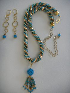 Russian spiral rope necklace with Swarovski Crystal sphere with fringe dangle. Cube dangle earrings.