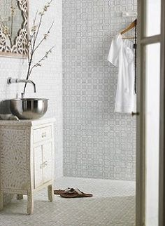 I love a bit of Andalusian glamour and the Monaco mosaic from Topps Tiles in it's cool grey tones is simply divine.