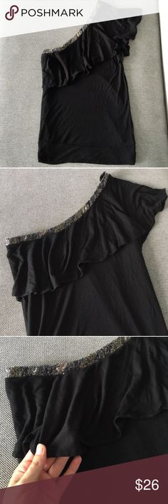 Black Ruffle Cold Shoulder Top! Super cute one-shouldered black top from Express! Has a flattering ruffle across the chest and sequined detailing on the diagonal neckline. Perfect for a night out! Only worn a couple times, in great condition! Size small. Express Tops