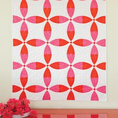 """The GO! Rings of Tangerine Quilt is just so fresh! This cousin of the classic Rob Peter to Pay Paul block, the GO! Flowering Snowball is ready for you to give it a go. 12"""" finished blocks help this quilt come together quickly, so you'll be snuggling under it soon.Compatible with these fabric cutters:GO! Studio**Must use with GO! Die AdapterLearn How to download quilt patterns.This pattern is included FREE on the packaging of the die GO!Flowering Snowball-12"""" Finished (55252). Fabric ..."""