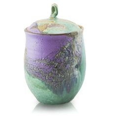 Hand made and kiln fired ceramic cremation urn in an elegant, eye-catching purple and green glaze finish