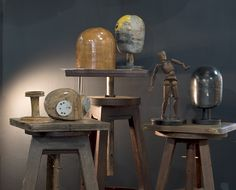 Antique moulds and an artists's figure create an effective display placed on antique turntables.