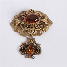 <b>Joseff Hollywood Layered Dangle Brooch with faceted amber stones.</b> H 3 3/4""