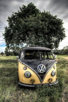 black and yellow splitty kmobi volkswagen bus in a field ☮re-pinned by @wfpblogs see more  #VWBus on https://www.pinterest.com/wfpblogs/vw-bus/