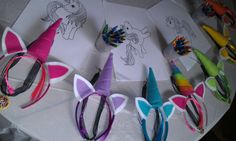 Rainbow unicorn party favors and activity- coloring pages printed off the internet, clip-in colored highlights, felt unicorn horn head bands, and resin rainbow sprinkle bottle cap necklaces.
