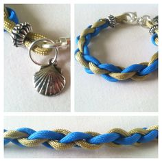 A more feminine approach to the typical Paracord Bracelets,    This one of a kind parcord charm bracelet is weaved with colonial blue & gold paracord.  Complimented with beautiful silver beads & a nautical seashell charm.