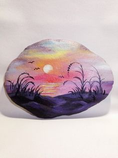 Lake at sunset painted on a stone