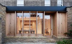 London-based O'Sullivan Skoufoglou Architects have transformed a Dewsbury Road home, with an extension characterised by warmth and minimal wooden design. Architecture Extension, London Architecture, Residential Architecture, Contemporary Architecture, Architecture Design, Minimalist Architecture, London Townhouse, London House, Black Metal Roof