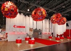 Exhibition stand for Canon. I like the spheres in the roof but can't quite tell what they are. Nice use of the brand palette.