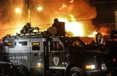 Ferguson County Police resorted to armored car with sniper on top as #Ferguson erupted following GJ decision