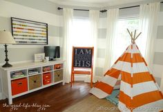 love the idea of a console table or entertainment unit in a child's room for all their stuff