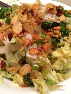 Asian Salad: Napa Cabbage (1.5+ lb) & green onion (3 or 4); Dressing: 1/2 cup light olive oil (or cannola), 1/3 cup cider vinegar, 1 tbsp soy sauce, 3 tbsp sugar, 2 pkt duck sauce (optional)- blend well | Topping: Brown 1 pkg crushed ramen noodles + 1/2 cup slivered almonds in 2 tbsp marg, add approx 1/2 pkt ramen noodle seasoning while browning - makes at least 4 servings; add chicken if desired! | #asian #salad #sidedish #ramennoodles