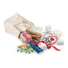 "Satisfy Mom's sugar tooth with this gift of all things sweet. A DEAN & DELUCA Mini Tote comes packed with homemade Vanilla Marshmallows, Kubli Fruits de Mer hard candies, an ""I Heart Mom"" Cookie and three DEAN & DELUCA Purist Choice Chocolate Bars"