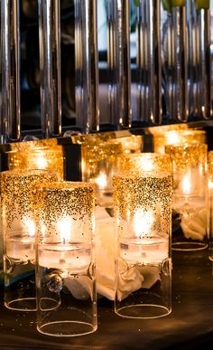 DIY Glitter Candle holders for your wedding or special event. So easy and really dress up plain glass candle holders!