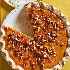 A swirl of maple syrup turns this classic pumpkin pie into a holiday favorite. Crunchy pieces of homemade salted pecan brittle finish the dessert./