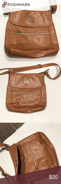 Kim Rogers Leather organizer cross body bag ~Kim Rogers ~ VERSATILE, convenient, and oh so pretty!! This is a brown, leather shoulder/cross body organizer bag!  This bag is so stinking accommodating and functional; it has a built in wallet, TONS of compartments, an adjustable strap and multiples inside and out zip closures. Seriously ran out of pic space.  Pre-Loved, plz look at pics closely, tried to show details OFFERS ALWAYS WELCOME! =)  I am new to POSH, but I'm open to…