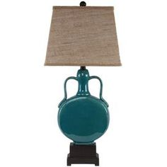 Ceramic table lamp.Product: Table lampConstruction Material: Ceramic and fabricColor: BlueAccommodates: (1) Bulb - not includedDimensions: 24.41 H x 14.96 W x 11.42 DCleaning and Care: Wipe clean with a dry cloth