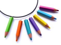 Funny pencil necklace for artists and everybody who likes life colourful.    The pencil is made out of recyceled synthetic resin, therefore it is wood