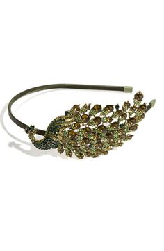 Tasha 'Fancy Schmancy Peacock' Headband   Be the first to write a review  Facebook  Twitter | discuss this itemGlittering gems light up the peacock ornament at one side of a satin-covered headband.Metal/polyester/crystals.  By Tasha; made in the USA.