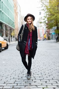 Hanging a scarf loose around your neck and topping your head with a brim hat is a simple way to gussy up the classic denim-shirt-and-black-skinnies look.
