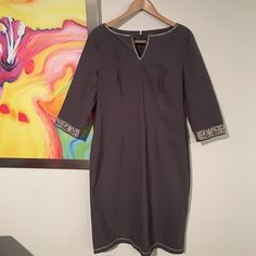 """Vintage Embroidered Sheath Dress Circa 1993. Elegant dark grayish purple sheath dress with silver ribbon embroidery on the split neck, hem and sleeves. Has been in storage and is in very good condition. Measurements taken while flat: Length 43"""" Chest 19"""" Waist 18"""" Hip 23"""" Vintage Dresses"""