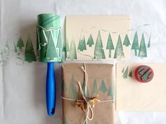 A genius idea for making wrapping paper using a lint roller and some hand-carved stamps.
