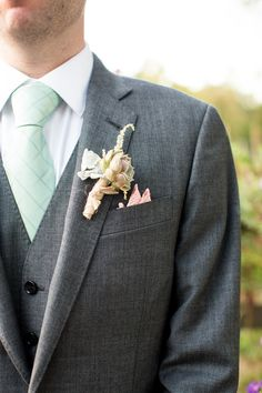 Whimsical Boutonniere - See the wedding here: http://www.StyleMePretty.com/tri-state-weddings/2014/04/09/queens-county-farm-museum-wedding/ Photography: Dutton + James - www.duttonandjames.com