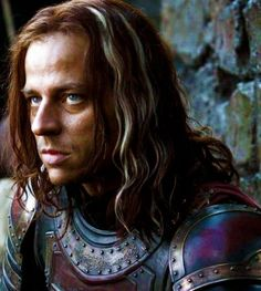 """Jaqen H'ghar is a name used by a member of the Faceless Men, assassins who follow a personification of death known as the Many-Faced God, so named because they can change appearances at will~~Vahlar Morgoulis is the greeting used by the Faceless Men, which translates to """"all men must die"""" in High Valyrian. It is a customary saying in Essos, and is traditionally answered with """"Valar Dohaeris,"""" meaning """"all men must serve."""""""
