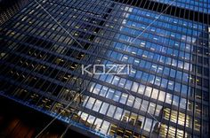illuminated windows of office building. - Low angle shot of illuminated windows of commercial building at night.