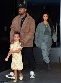 These boots are made for walking: The quartet were earlier snapped leaving their hotel with Kim daring to impress in billowing sweatpants matched with black suede heels Kanye West Outfits, Kanye West Style, Kanye West And Kim, Kanye West North West, Kanye West Fashion, Kenye West, Kardashian Family, Kardashian Style, Kardashian Jenner