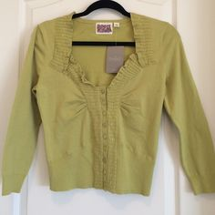 Anthropologie Rosie Neira Ruffled Knit Top NWT! Anthropologie Rosie Neira knit top.  Ruffled neckline with embroidered detail.  Size medium in a soft lime color.  Button front and could also be worn as a cardigan.  Slightly cropped with 3/4 sleeves.  Tag attached (with price crossed out). Anthropologie Tops