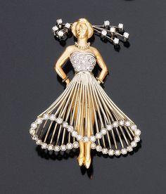 Spilla in oro bicolore e brillanti raffigurante una ballerina che danza sulle punte, orlo del vestito, bustino e parte dell'acconciatura in brillanti taglio huit-huit, 1950 circa. A TWO-COLOURED GOLD AND DIAMOND BROOCH