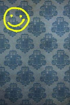 Sherlock smiley face on a TARDIS wallpaper.
