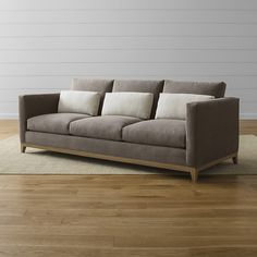 """Shop Taraval Transitional Sofa with Oak Base.   Completing the pure """"gold standard"""" comfort experience are an eight-way hand-tied spring suspension system that supports your every move, and seat and back cushions wrapped in extra layers of luxurious down."""