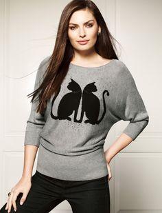 Mirror image cat sweater.