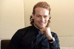 Sam with a sweet smile.  And a bouffant hairdo.