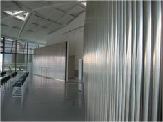 This is the entrance area of a meeting room at City Hall, London. The room has room dividers that are made of stainless steel. The surface is very reflective. The light from the large windows is bouncing off the floor and walls making it a very confusing for visually impaired people. It would be difficult for a person with visual impairment to distinguish walls from the floor.   Image courtesy of Sandra Manley, UWE Visual Impairment, Distinguish Between, Room Dividers, Large Windows, Entrance, Surface, Stainless Steel, Flooring, London