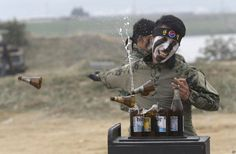 A South Korean army special forces soldier breaks bottles with his hand during…