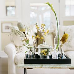 Contain Yourself - For a garden-fresh display, assemble a collection of mismatched glassware, along with interesting flowers, greenery, and moss from a garden or floral shop
