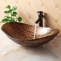 With a European influence, this lovely glass vessel sink adds to the beauty of any bathroom.    #bathroom #sink