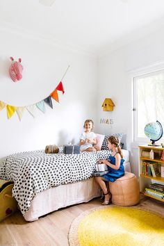 Colourful girls' bedroom with bunting.  | Photo: Maree Homer | Styling: Ashley Pratt | Story: Australian House & Garden