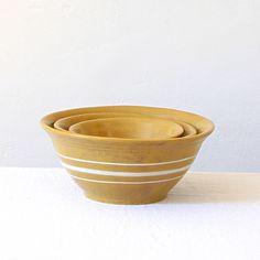 Bowl Vintage Yellow Ware Mixing Bowls Set of Three Rustic Cottage Primitive Yellow White Stripe Stoneware Pottery by jillbent on Etsy https://www.etsy.com/listing/248970028/bowl-vintage-yellow-ware-mixing-bowls